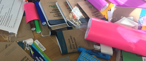 Pile of materials and Field Guides with student names on them