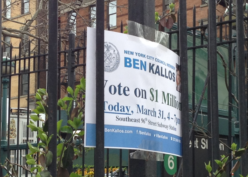 Sign for participatory budgeting taped to a fence in Manhattan